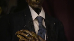 Mummified man in suit - horror imagery Stock Footage