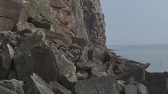 Slow Motion Jib Shot of Coastal Cliff Made of Sandstone and the Sea Stock Footage