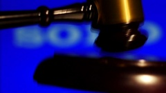 Slow motion auctioneer gavel hits Stock Footage