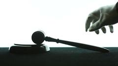 Slow motion Judge hitting gavel hits against white back Stock Footage