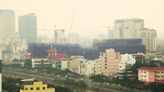 Multiple construction cranes working in a residential area of Ho Chi Minh City Stock Footage