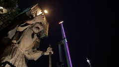 Prague - February 2016: Monster in Amusement Park at night, moves its mouth Stock Footage