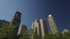 Drive shot of midtown Chicago highlighted by the Sears Tower. Stock Footage