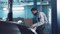 African mechanic open hood and check engine Stock Footage