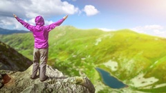 Woman on top of a mountain Stock Footage