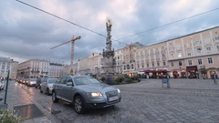 Time lapse of a busy Linz street with traffic and a subway Stock Footage