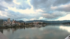 Time lapse of the Danube River in Linz, Austria on a cloudy Fall day Stock Footage