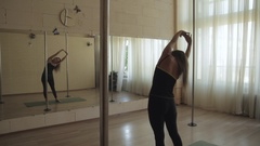 Young girl doing a workout in the gym with large mirrors, a dance hall dance Stock Footage