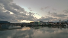 The sun sets on the Danube River in time lapse in Linz, Austria Stock Footage