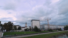 Time lapse video of nightfall on the banks of the Danube River in Linz, Austria Stock Footage