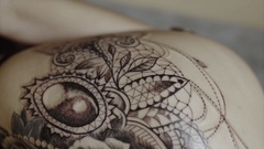 Close up shot of finished tattoo on woman's body Stock Footage