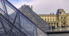 Sliding time lapse view of the Louvre museum and the pyramid in Paris Stock Footage