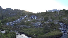 Lofoten islands,Norway.Mountain waterfall in evening.Hiking trip. Beautiful view Stock Footage