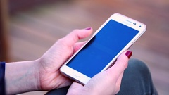 Hand Holding Smartphone With Facebook Social Network Mobile App Stock Footage