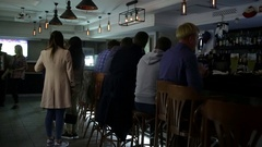 September 23, 2016 Dnepr, opening a new pub, people celebrate and watch football Stock Footage