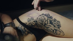Tattoo artist preparing skin of his client to the process of making tattoo Stock Footage