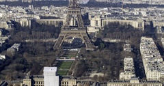 Tilt up arial time lapse view of the Eiffel tower in Paris Stock Footage