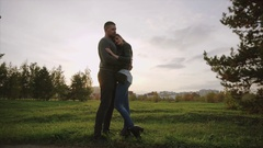 Young couple enjoying each other in the autumn park Stock Footage