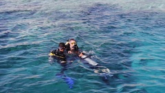 Sharm el-Sheikh, Egypt -  divers in aqualung prepare to dive on Stock Footage