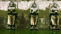 Hindu Goddesses statues making religious offerings. Goa Gajah, Bali. Indonesia Stock Footage