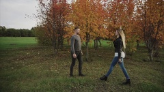 Young happy couple meet in the autumn park Stock Footage