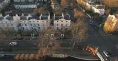 Aerial sliding view of an elegant residential area in London by a canal Stock Footage