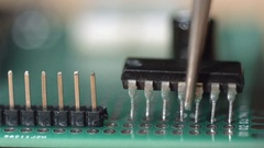 Insert microchip in green electronic circuit board Stock Footage