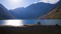 MoCo Astro Timelapse of Moonset over Alpine Lake in Eastern Sierra -Tilt Up- Stock Footage