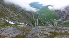 Trollstigen aerial over Stigfossen waterfall at trolls ladder Norway Stock Footage