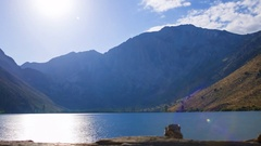 MoCo Astro Timelapse of Moonset over Alpine Lake in Eastern Sierra -Zoom Out- Stock Footage