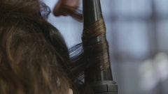 Curling Iron in Use Stock Footage