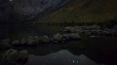 MoCo Astro Timelapse of Stars over Alpine Lake in Eastern Sierra -Tilt Up- Stock Footage
