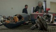 Electrical tools in focus,repairmen working in the blurred background by Sheyno. Stock Footage