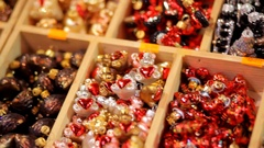 Many multi-colored sparkling Christmas tree decorations in box. Stock Footage