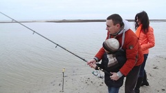 The father teaches his son to throw the bait. Autumn Fishing Rods Stock Footage
