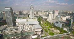 Drone Shot of Pratunam Shopping District and Bayoike Tower in central Bangkok Stock Footage