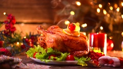 Christmas holiday family dinner. Decorated table with roasted turkey Stock Footage