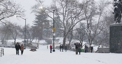 Tourists Walk Near an Entrance to Central Park in a Snowstorm   Stock Footage