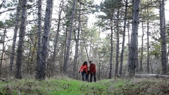 Family in autumn forest. Walk a happy family from three persons Stock Footage