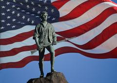 Minuteman Statue and US Flag Stock Photos