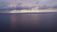 Orange and Purple Sunset Glowing Light Over Puget Sound Bainbridge Island Oly Stock Footage