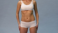 Female body part in white sport underwear. 4K Video Stock Footage