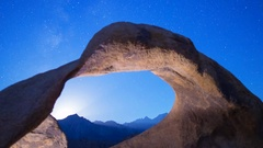 Astro Timelapse of Moonset & Galaxy thru Mobius Arch in Eastern Sierra -Zoom Out Stock Footage