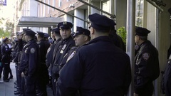 NYPD police officers lined up ready for protesters on winter day in NYC Stock Footage