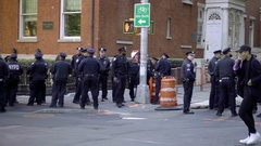 Group of NYPD police officers congregated on corner street University Place NYC Stock Footage
