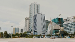 Daytime view of the main square in Nha Trang with skyscrapers Stock Footage