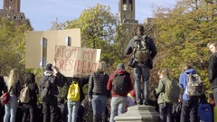 Not My President sign anti-Trump people rally protest Washington Square Park NYC Stock Footage