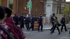 NYPD police officers crossing the street on winter day on University Place NYC Stock Footage