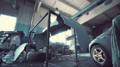 Interior of an auto repair garage with blue tone Stock Footage