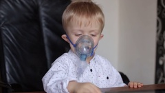 Little boy makes inhalation in the electric inhaler. Stock Footage